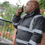 security guard speaking into radio